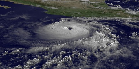 """This June 9, 2011 National Oceanic and Atmospheric Administration (NOAA) GOES satellite image shows Hurricane Adrian, a Category 3 hurricane with sustained winds of 115 knots off the west coast of Mexico. Conditions are favorable for further strengthening in the next 24 hours before the storm begins to be affected by stable air and cooler waters. Adrian is moving west northwest and should pose no problems for land.  Adrian strengthened to a major hurricane Thursday off the Pacific coast of Mexico, with sustained winds of 115 miles (185 kilometers) per hour but posing no immediate threat to land, the US National Hurricane Center said. AFP PHOTO/NOAA/HANDOUT/RESTRICTED TO EDITORIAL USE - MANDATORY CREDIT """" AFP PHOTO / - NO MARKETING NO ADVERTISING CAMPAIGNS - DISTRIBUTED AS A SERVICE TO CLIENTS"""